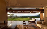 Living room in the foreground and landscape in the background