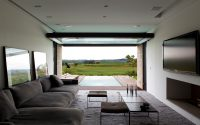 TV room into the cantilevered volume with the swimming pool in t