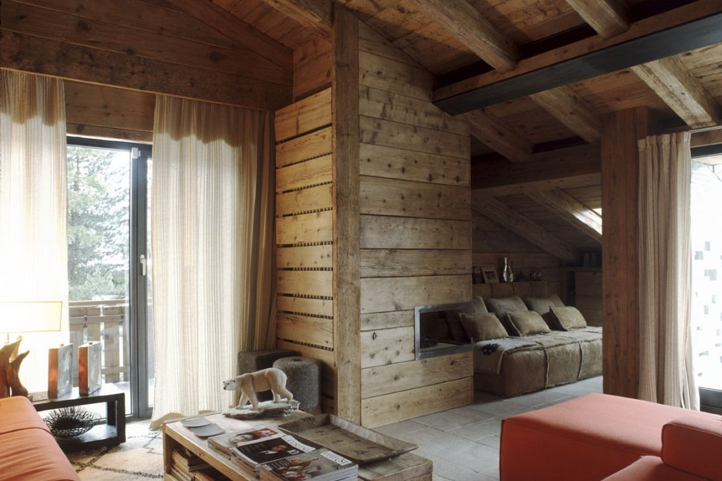 Attic in Cortina d'Ampezzo by Mario Mazzer Architects